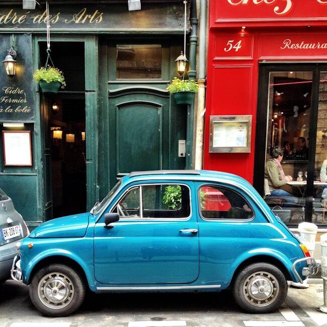 Turquoise Vintage Fiat 500 on Rue Saint Andre des Arts Paris France