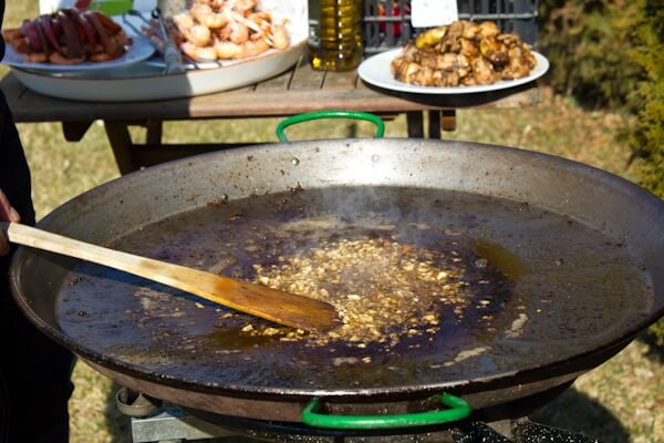 Adding Garlic to the Paella