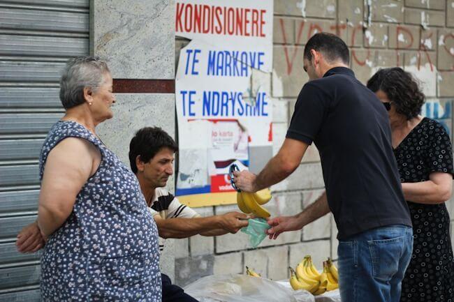 Selling bananas on the street in Berat