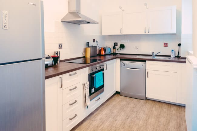 Kitchen as you walk in the apartment