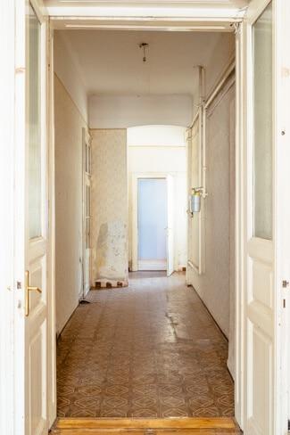 Huge hallway leading to small back room